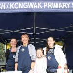 Fry up: Michelle Sim and Sam, Jayla and Ella Morcom were cooking up a storm under the Inverloch/Kongwak Primary School tent at the Inverloch Farmers Market on Sunday.