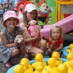 Lucky ducks: Lucy, Ava and Florence Patterson from Leongatha show off their prizes after picking ducks at the Wonthaggi show.