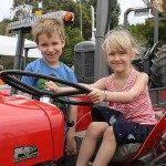 From city to country: Harrison and Charlotte Leeder from Melbourne took charge of a tractor's steering wheel at the Wonthaggi show.