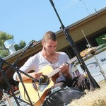Music man: Dean Whitehouse was one of the many performers who kept the crowds entertained at Poowong on Sunday.