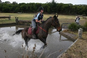Splish, splash: Julia Green of Toora on board Running Warrior tackles the water obstacle in the cross country course. Julia is a member of the Corner Inlet Pony Club.