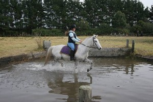 Handling wet: Coby Elmore of Corner Inlet Pony Club on board Benson during the cross country lesson. Coby hails from Bennison.