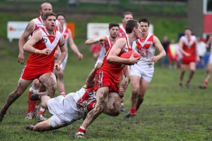 Red and white: Yarram's Luke LeBlanc shakes a tackle on Saturday.