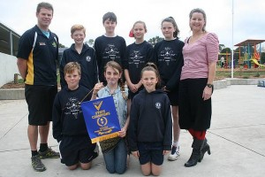 State winners: teachers Jesse Boyd and Clare Peterson (coach) with Inverloch Primary School's state champion mixed netball team. Back row, James, Campbell, Xanthe and Abby, in front are Cooper, Siohban and Lanni. Absent are Marcus, Michael and Zali.