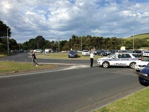 Banking up: police deal with mounting traffic at the Anderson roundabout near Phillip Island after Friday's crash. Photo by Paul Zennaro via Twitter.