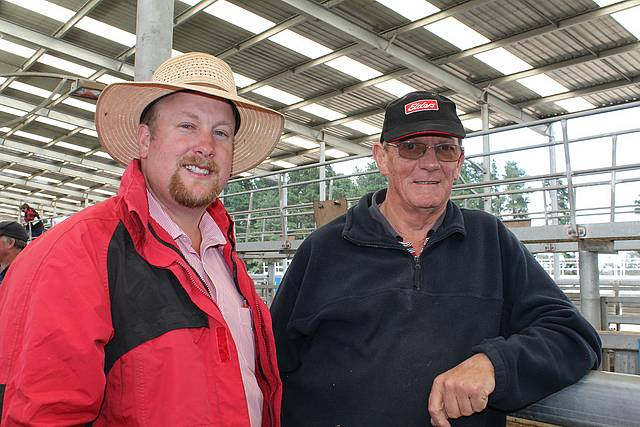 Selling well: stock agent Alex Dixon and Glen Richards from Glen Alvie at the store sale in Koonwarra last Thursday. Mr Richards had a pen of weaners in the sale.