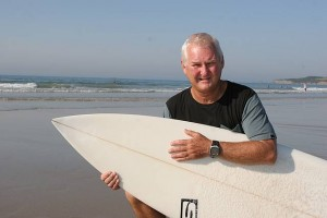 Inverloch's Max Wells, at the town's surf beach, has received a Medal of the Order of Australia for his contribution to surfing and the community.