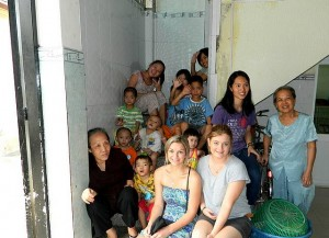 Cherished friends: Laura Robins and Ashleigh Gobel with some of the children at the Truyen Tin Orphanage in Vietnam.