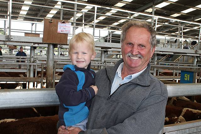 Keeping in touch: Phil Benson from Buffalo with his grandson Alistair Tuckett at the store sale last Thursday. Mr Benson has recently sold his farm, but still enjoys the sales.