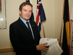 Recently released: Bass Coast Shire Council mayor Cr Neil Rankine flips through the budget draft released to the public on Wednesday.