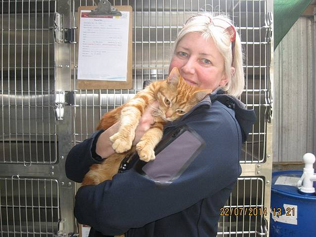 Register your pet: Bass Coast Shire Council's senior animal management officer, Lukretia Szova, with an impounded cat that was later reunited with its owner.