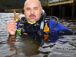 Got it: Parks Victoria operations officer Matt Hoskins with a Northern Pacific Seastar from Tidal River in 2012.