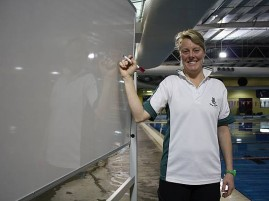 Lorrie McKenzie: the Leongatha Swimming Club coach is happy with the new white board, purchased with a grant from South Gippsland Shire Council.