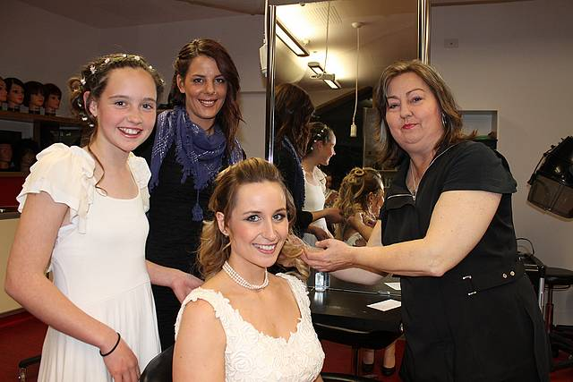 Bride style: Miki Hilliar and Ashlee Hilliar from Mirboo North, Lisa O'Donnell from Pakenham and Lisa Galley from Warragul make last minute adjustments before joining the crowd at the gala night held at Leongatha last Wednesday.