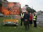 Message for drivers: from left, Leading Senior Constable Paul McDonald of Meeniyan, South Gippsland Shire Council's Road Safety Group representative John Ernst, deputy mayor Cr Jeanette Harding and Acting Sergeant Allan Piening of Bass Coast Highway Patrol with the new sign.