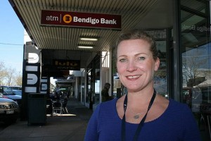 Stay local: South Gippsland Shire Council's business liaison officer Renae Littlejohn encourages shoppers to shop at small businesses on Support Small Business Day, Saturday, October 4. She is pictured in Leongatha's commercial strip.