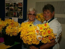 Lots of daffodils: Joy Dyson and Thelma Arnup surround themselves with daffodils at the show on Thursday.