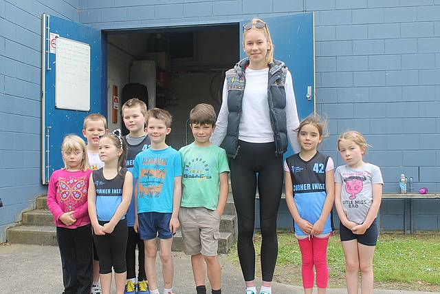 Local hero: from left, Riley, Zack, Brooklyn, Jordan, Tom, Joshua, Eleanor Patterson, Summer and Lily at the opening of the Little Athletics season in Foster.  Commonwealth Games gold medallist Eleanor Patterson was on hand to open the season and her autograph proved highly popular with the youngsters.