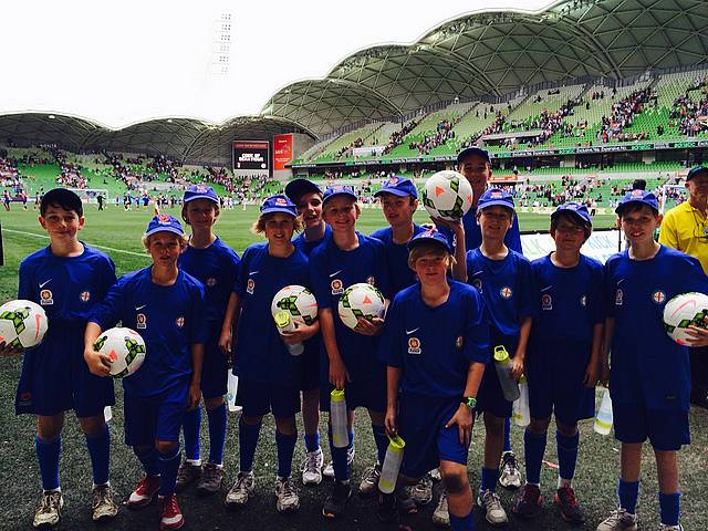 Up close: from left, Kelsey Dal Pozzo, Oscar Plenkovich, Harry Gibson-Goldsmith, Travis Cristall, Eamonn Toomey, Dimitri Vanos, Dion Renton, Jasper Kempster, Scout Greenhalgh, Quinn Brookes-Page, Oscar Gibson-Goldsmith and Blake Richards pitch side at AAMI Park.