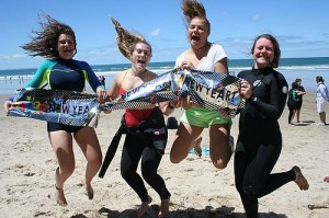 Happy New Year: from left, Elise De Santis, Kahlia Truman, Jasmine Cook and Sally Mildenhall celebrate the remaining days of 2014 at the Inverloch surf beach on Saturday, and are excited about the year ahead.