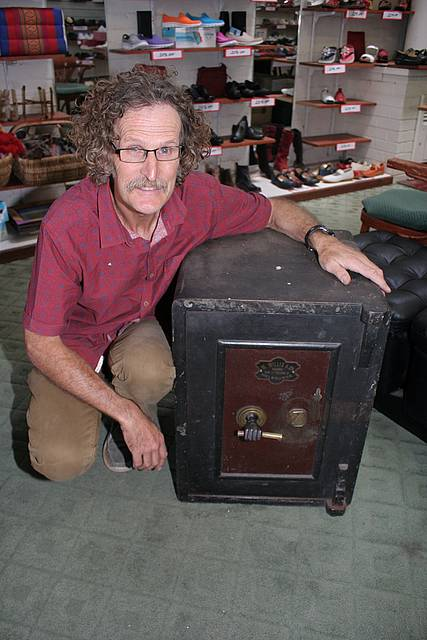 Local history: Ted Egan of Leongatha Shoegallery with a 100 year old safe that is for sale with the shoe shop and shoes.