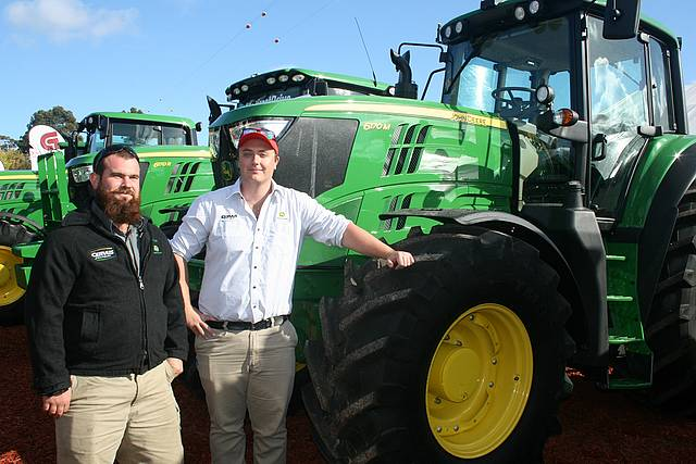 Latest models: from left, Cervus Equipment sales consultants Andrew Cherry and Shaun O'Hara were showing off the new John Deere models and the latest GPS technology.