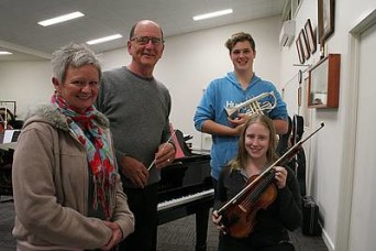 "Anzac songs: from left, pianist Carmel Slater of Leongatha, composer and conductor Larry Hills of Wonthaggi, cornet player Mitchell Brusamarello of Korrine and violinist Sarah Basile of Korumburra rehearsing at Wonthaggi Citizens' Band's rooms for ""They Went with Songs""."