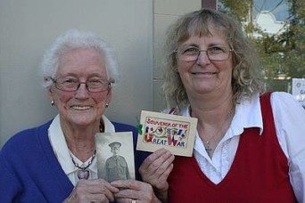 Family artefacts: Marj Prosser of Koonwarra, left, with a photograph of her late father, Alexander Duncan Alexander, who served in World War One, and Mrs Prosser's daughter Bev Coulter of Leongatha with a letter Mr Alexander sent home from the Western Front.