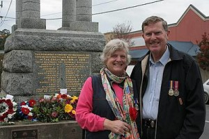 Family connection: Jill Harris, left, and Ron Harris, both of Foster, at the Foster cenotaph after the Anzac Day service. Ms Harris has an ancestor's name inscribed on the cenotaph and Mr Harris is a serving member of the armed services.