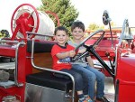 Little engines: Tyson (left) and Brodie Lund from Leongatha enjoyed having a look at Ray Argento's vintage fire engine on Sunday, as part of the Leongatha Fire Station official opening.
