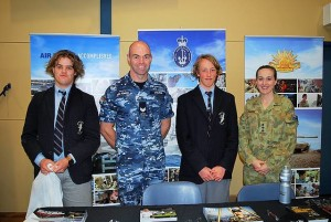 Considering options: Newhaven College students Lachlan Halley (left) and Henry McKay (right) spent time discussing career options with Dallas Young and Angela Madden from Defence Jobs.