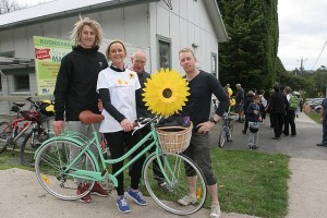 Riding for a cause: from left, Dyson, Ann-Maree and Paul Heppell with Bede Stallard were overwhelmed by public support for the scleroderma fundraiser. Mrs Heppell's mother Corry Schelling died from the condition and Mr Stallard's mother Rae Stallard lives with it. They are at the Koonwarra Hall.