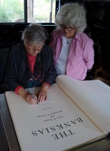 Book signing: Celia Rosser signs Carolyn Landon's own copy of the florilegium The Banksias Volume 1, a 25 year-long project where Mrs Rosser painted every species of banksia.