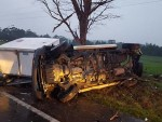 Lucky escape: an Inverloch man managed to get out of this mess when his ute and trailer tipped over and broke up at Leongatha North.