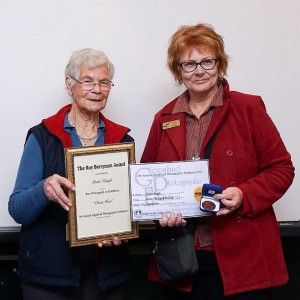 Well deserved: from left, Elaine Berrymam (wife of the late Roy Berryman OAM) presented the inaugural Roy Berryman award to best photograph in exhibition winner Linda Keagle of Foster Camera Club.