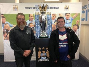 Rousing: from left, Korumburra City Soccer Club committee member David Hurst and club vice president Michael DuVe attended the English Premier League trophy presentation earlier this year and witnessed an inspiring speech by Manchester United goal keeper, Mark Williams.