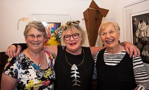 Art unites: from left, Glenda Ross of Leongatha, artist Leslie Monahan of Meeniyan, and Avril Van Wamel, also from Meeniyan, were not only enjoying the art, but the wonderful atmosphere at the Meeniyan Art Gallery at the opening of three new exhibitions.