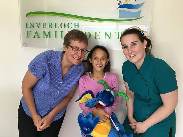 Families win: eligible children can receive up to $1000 worth of dental treatments over two years, through the Federal Government's Child Dental Benefits Schedule delivered by Medicare. From left, Dr Tonya Kirk, Nenita, 11, and dental assistant Hannah Gray at Inverloch Family Dental.