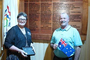 Shining citizen: from left, Maxine Kiel and husband Colin Kiel stand by the Australia Day board where Mrs Kiel will forever be recognised as Citizen of the Year.