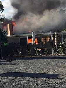 Well alight: firefighters worked to extinguish the fire at From the Ground Up Cafe Nursery at Wonthaggi on Sunday.
