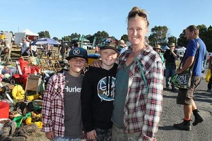 Bargain hunting: from left, Tom Rule, Austin Cousins-Earle and Caz Cousins from Somerville found some things to take home at the swap day on Sunday.