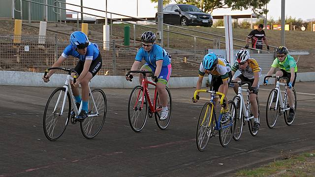 Close watch: from left, Junior riders competing in the five lap scratch race on Friday night at the Leongatha velodrome are Oliver McLean, Felicity Waddell, Thomas Fitzgerald, Kaleb Jans and Josh Wight.