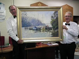 Best oil: from left Korumburra Rotarians Euan Coutts and Stewart Woods display artist Diana Edwards' Reflections Metung work that was awarded the best oil painting in the show.