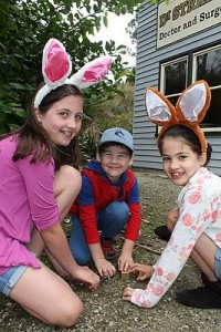 Found some: from left, Phoebe, Riley and Ebony Collins from Leongatha found all the booty they could carry at the Coal Creek Easter egg hunt on Sunday.