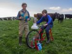 Riding for farmers: from left, Hugh and George Nicoll make a milk smoothie on a smoothie bike ahead of the football match at Fish Creek this Saturday, when Fish Creek takes on Kilcunda-Bass.