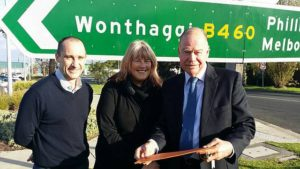 Election announcement: from left, Bass Coast Shire Council's manager for assets Jamie Sutherland and general manager for infrastructure Felicity Sist with McMillan MP Russell Broadbent at the Bass Highway and Korumburra-Wonthaggi Road intersection in Wonthaggi. The Coalition Government has promised to build traffic signals at the busy junction if re-elected.