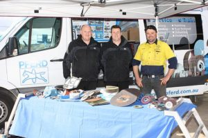 """In the know: from left, Tim Hailes and Shaun Besim of Pferd, abrasive supplier for BJ Bearings, chats to Andrew Sage of Andrew Sage Engineering, covering all general engineering, based in Leongatha.  Andrew said, """"There are really great deals on offer today and I am always well looked after by the staff at BJ Bearings Leongatha""""."""