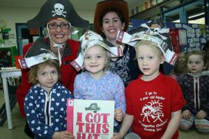 Fun book: from left, Maggie, Eve and Jayden from Leongatha Children's Centre put on their hats and enjoyed the book I Got This Hat with West Gippsland Regional Library Corporation's Heather Withers (left) and Aimee Abel.