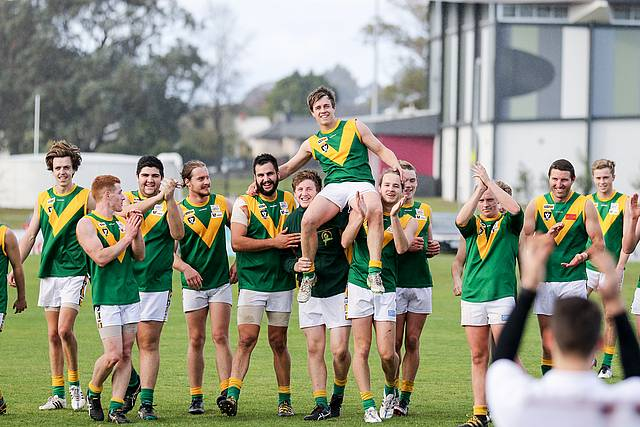Milestone: Leongatha's Jess Hickey is chaired off the ground in the Reserves after celebrating his 150th club game.