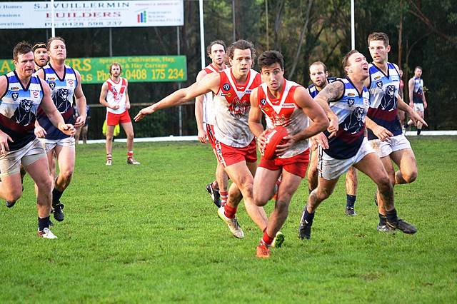 Top roo: Fish Creek's captain Callan Park was shepherded by teammate Matt Kreymborg in this gather. Park kicked two goals in the Kangaroos' massive win over Kilcunda-Bass.
